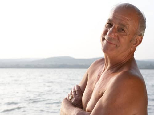 Happy older man by the sea