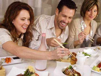 Friends eating Asian food