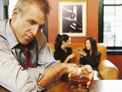 Man at bar with whiskey