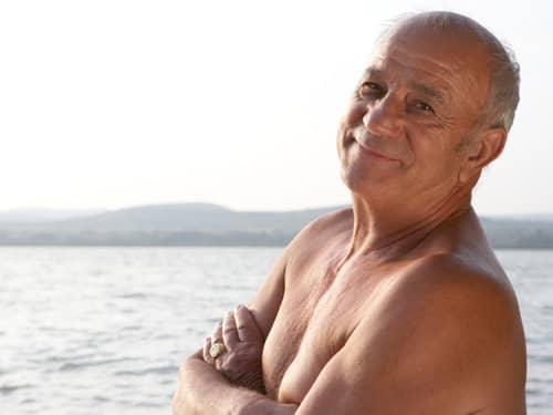 Relaxed man by beach