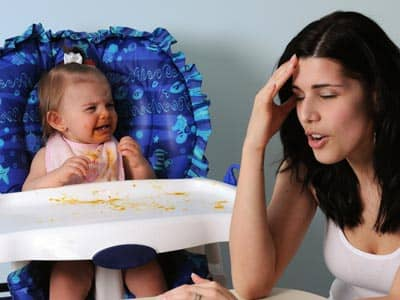 Frustrated mother and baby