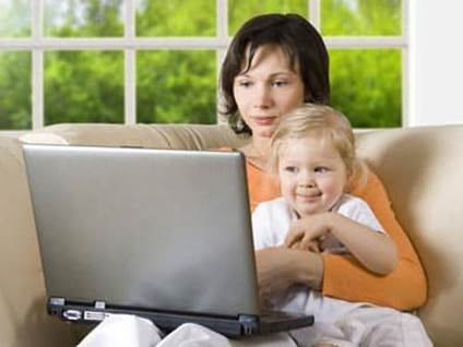 Mom and baby surf the internet on a laptop