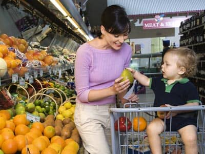 A mother and baby in a grocery store