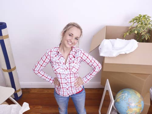 Young woman unpacking