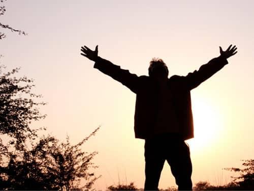 Man raising arms in triumph