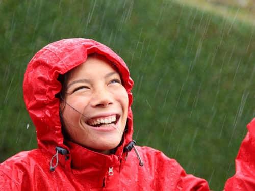Woman smiling in the rain