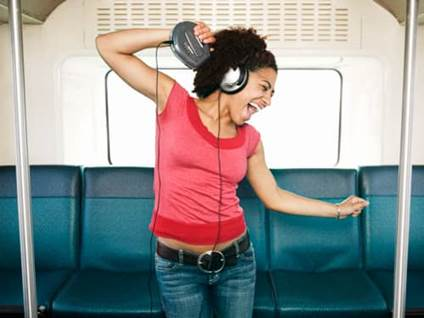 Woman with headphones on subway