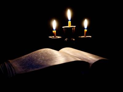 Holy book with candles