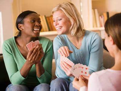 Girlfriends playing cards