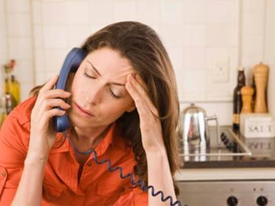 Woman with headache on phone