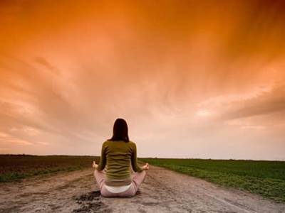 Woman meditate sunset