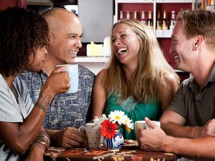 Laughing friends at bar