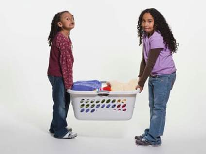 Kids carrying heavy laundry basket