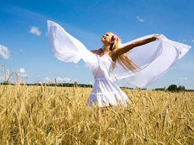 Woman dancing in a field