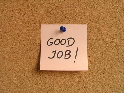 Good Job posted on cork board