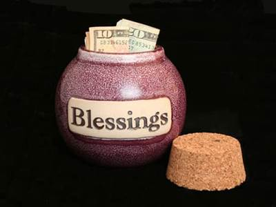 Money in blessings jar