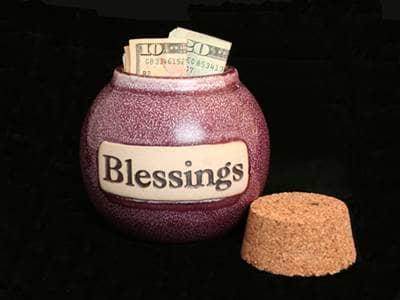 Money in blessings jar