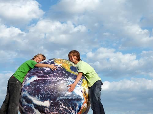 Two people hugging the Earth