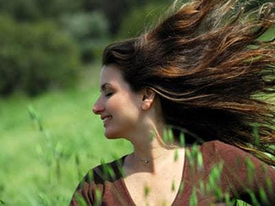 Woman in a breezy meadow