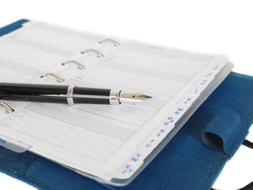 Datebook and pen
