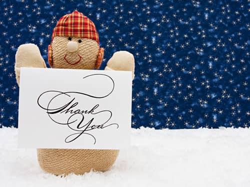 Puppet holding thank you card