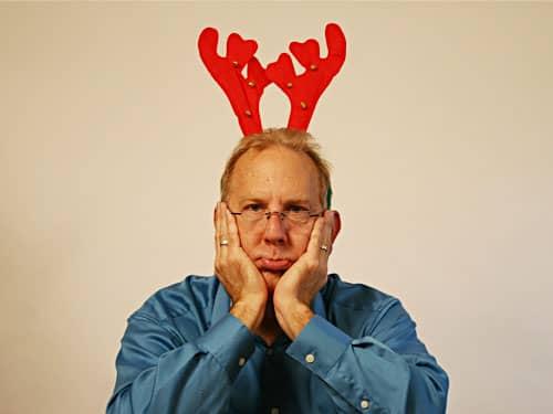 Sad man with reindeer horns