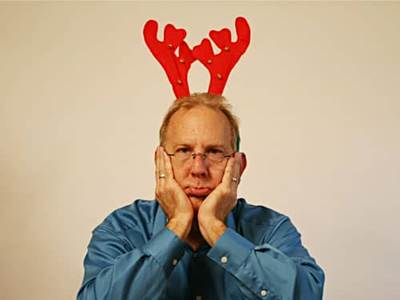Sad man with reindeer horns