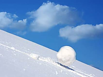 Snow ball rolling down hill