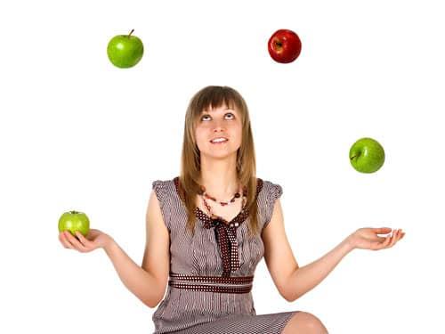 Woman juggling apples