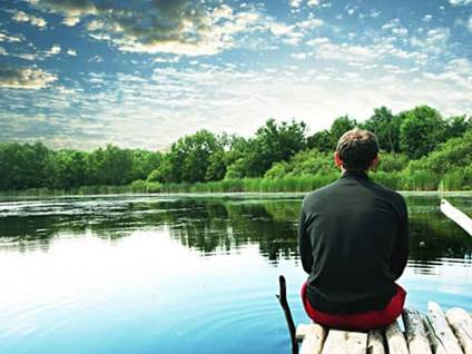 Man relaxing on a dock