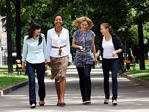 Four friends walking in a park