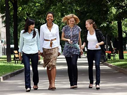 Four friends walking in a park