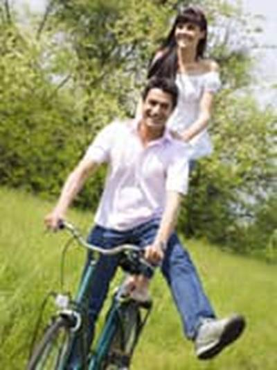 couple riding bicycle having fun