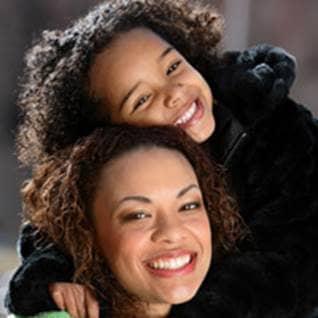 mother daughter together smiling