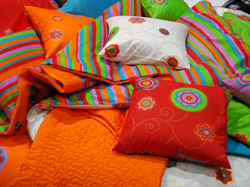 Many rainbow-colored pillows
