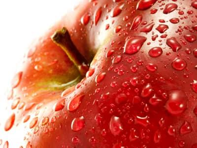 A close up of a wet apple