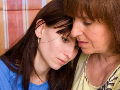 Upset daughter and comforting mother