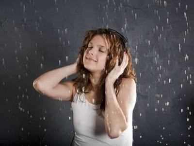 Woman with headphones in the rain