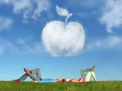 Couple in field and apple cloud
