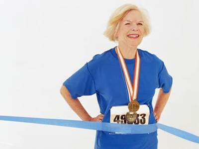 Older woman finishing a race