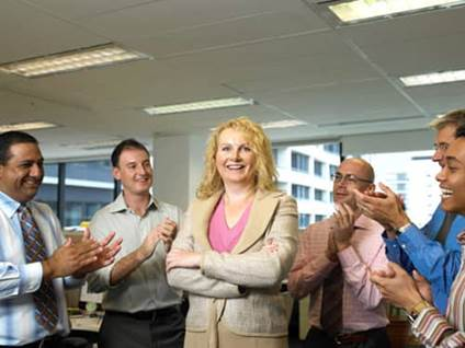 Woman applauded at work