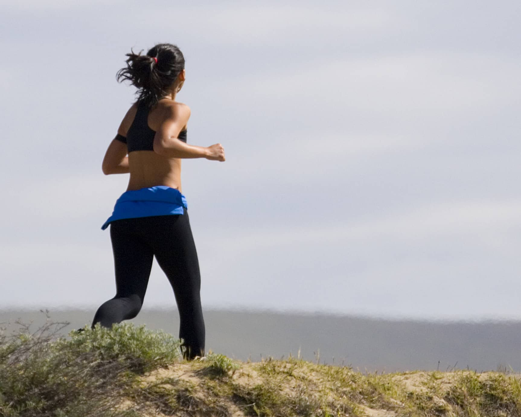 Jogging woman in grass