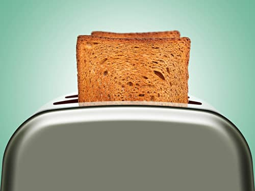 Toaster with pieces of bread