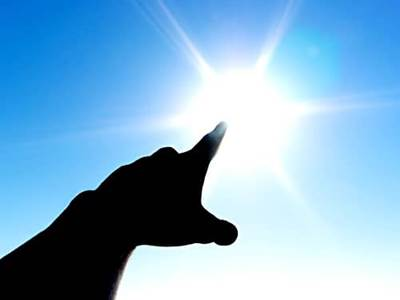 Finger pointing to the sun