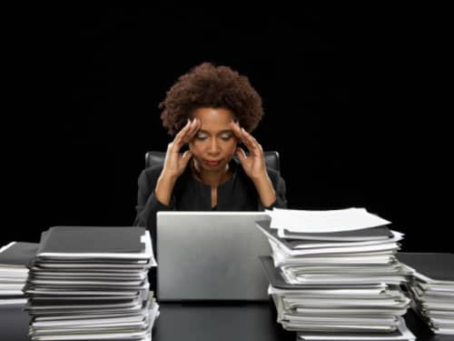Overwhelmed woman at a desk