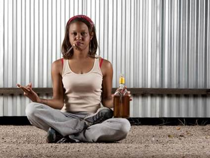 Woman drinking and smoking while meditating