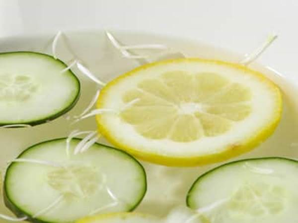 Lemon and cucumber slices in water