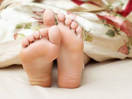 Feet under covers