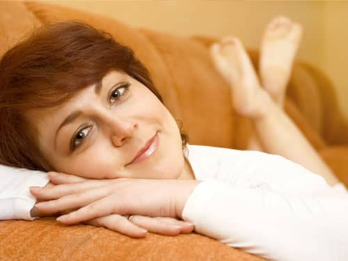 woman relaxing on a couch