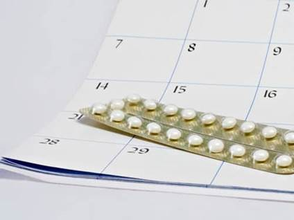 Birth control pills on calendar
